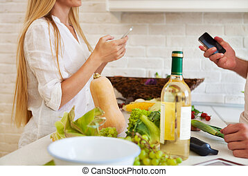 Couple cutting vegetables at the kitchen. Couple preparing dinin