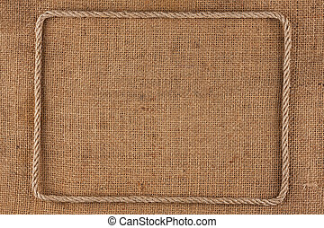 Frame of rope, lies on a background of burlap, with place...