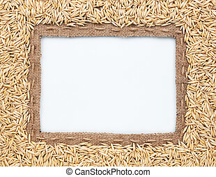 Frame of burlap and oats beans, lying on a white background...