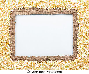 Frame of burlap and millet beans, lying on a white...