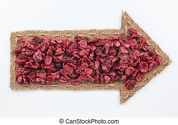 Pointer of burlap with dried cranberry , on a white...