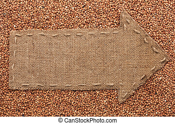 Pointer of burlap lies on buckwheat grain, with place for...