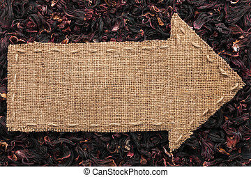 Pointer of burlap lies on hibiscus, with place for your text...