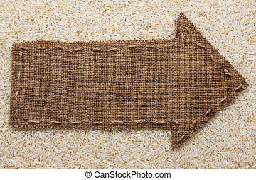 Pointer of burlap lies on rice grain, with place for your...