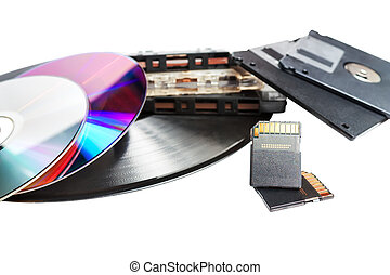 Obsolete and modern storage devices close-up isolated