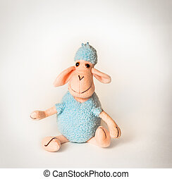 soft toy lamb on a white background