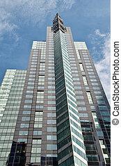 modern office skyscraper on blue sky