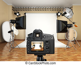 DSLR camera in photo studio with lighting equipment, softbox...