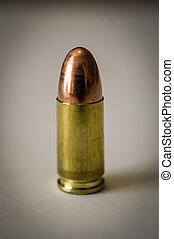 Bullet - Single bullet isolated on white background .