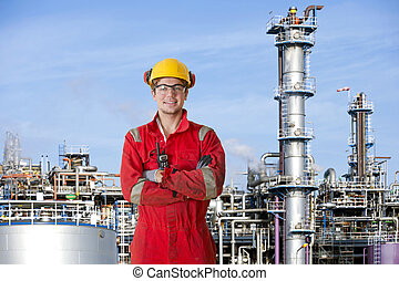 Petrochemical factory operator - Smiling man with his arms...