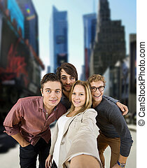 Big City Selfie - Four tourists taking a selfie during a...