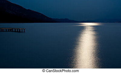 Blue moon reflected on the ocean - Harvest moon reflected on...