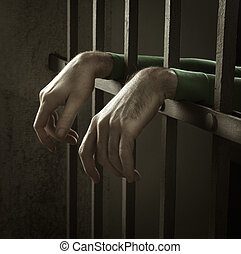 Man in jail hands close-up, depression and despair concept