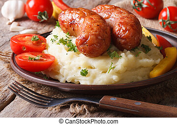 delicious sausages with mashed potatoes and fresh vegetables...