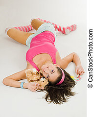 Young woman in pink lay with toy