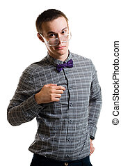 Handsom young man in shirt with bow wearing glasses look at...