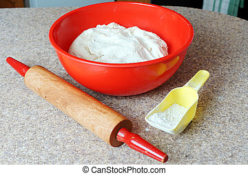 Dough and baking objects - Big red bowl of dough, rolling...