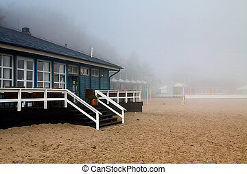 Beach house in fog with balustrade and stairs