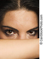 Hidden woman - Beautiful woman hidden face with hand and let...