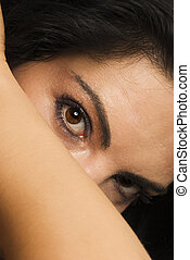 Brown eyes - Beautiful woman standing with head...
