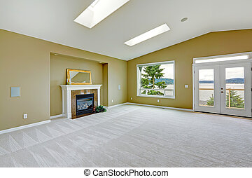 Empty spacious living room with walkout deck and fireplace...