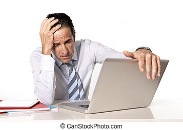 desperate senior businessman in crisis working on computer...