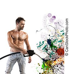 Sexy man with fuel pump and colorful effect