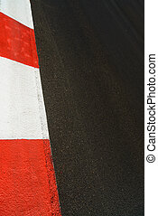 Texture of race asphalt and curb Grand Prix circuit -...
