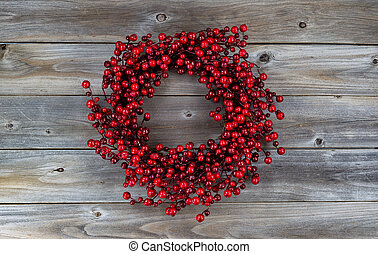 Red Berry Holiday Wreath on Wood - Red berry holiday wreath...