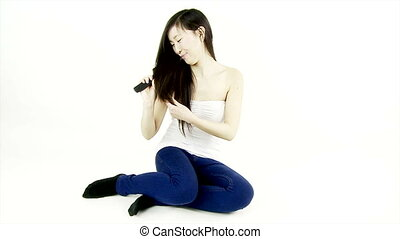 Chinese girl brushing long hair - Happy lady brushing long...