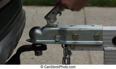 Taking trailer off ball hitch. - Lifting galvanized aluminum...