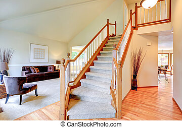 Bright ivory house interior with high vaulted ceiling. View...