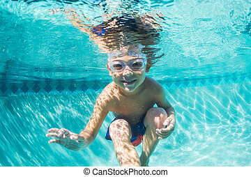 Young Boy Diving Underwater in Swimming Pool - Underwater...