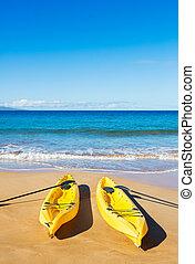 Ocean Kayaks on Sunny Beach - Two Yellow Ocean Kayaks on...