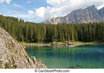 Carezza Lake and Rosengarten - Scenic view of Carezza lake...