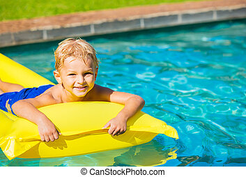 Young Kid Having Fun in Swimming Pool - Happy Young Boy...
