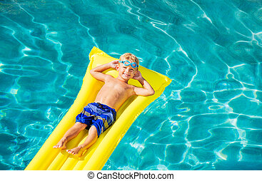 Boy Relaxing and Having Fun in Swimming Pool on Yellow Raft...