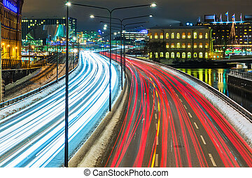Winter highway traffic in Stockholm, Sweden - Night scenery...