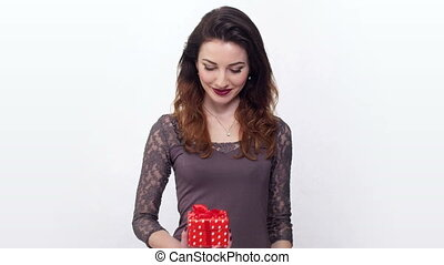 cute woman opens a gift box