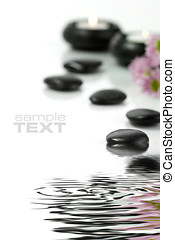 Time to relax - Pebbles, candles and flowers with soft focus...