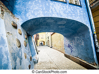 colorful houses in Warsaw - blue house with an arch in the...