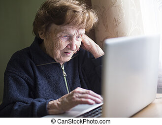Mature woman working on a laptop.