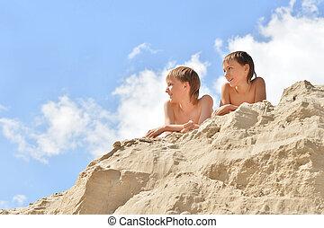 Two boys sitting