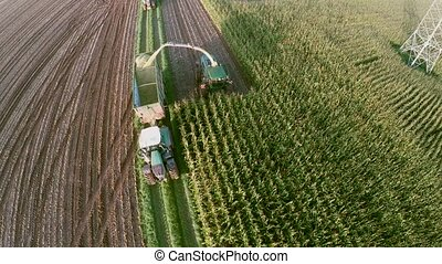 Aerial of harvesting a mais-field in germany