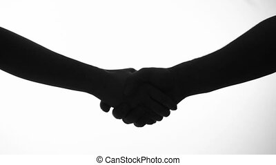 holding shaking hands silhouette