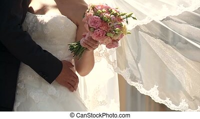 Wedding Couple with wedding bouquet