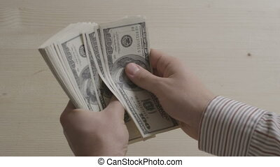 man counting dollars - hands of businessman counting dollar...