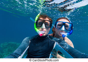 Couple snorkeling - Underwater photo of a young couple...