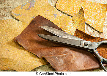Leather and scissors - Scissors for cutting leather on...