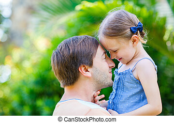 Father and daughter - Happy father and his adorable little...